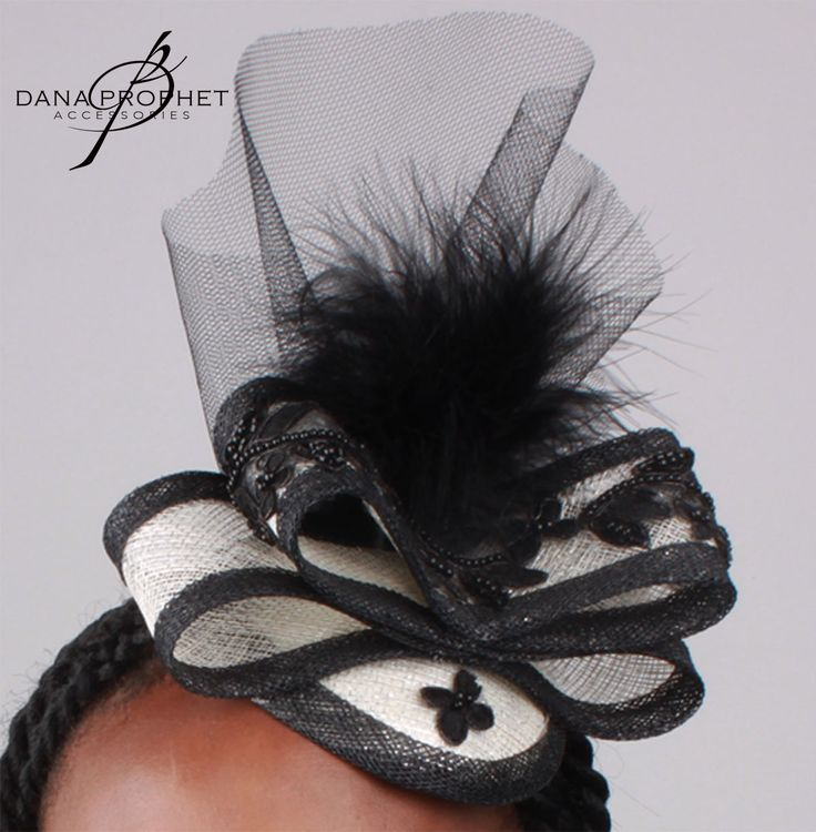 Black and White Bow Sinamay Fascinator with feather, black netting and trim. https://danaprophetaccessories.com/fascinators/black-and-white-bow-sinamay-fascinator/  #hat #fascinator #races #durbanjuly #horserace #fashion #style #kentuckyderby  #trending #sinamay #celebrations #wedding #bridal #bridesmaids #derbyhat #pillbox #headpiece #melbournecup #royalascot #derbyday #Oaksday #accessories #Black #White #blackandwhite #trim #mesh #net #feather #prophet