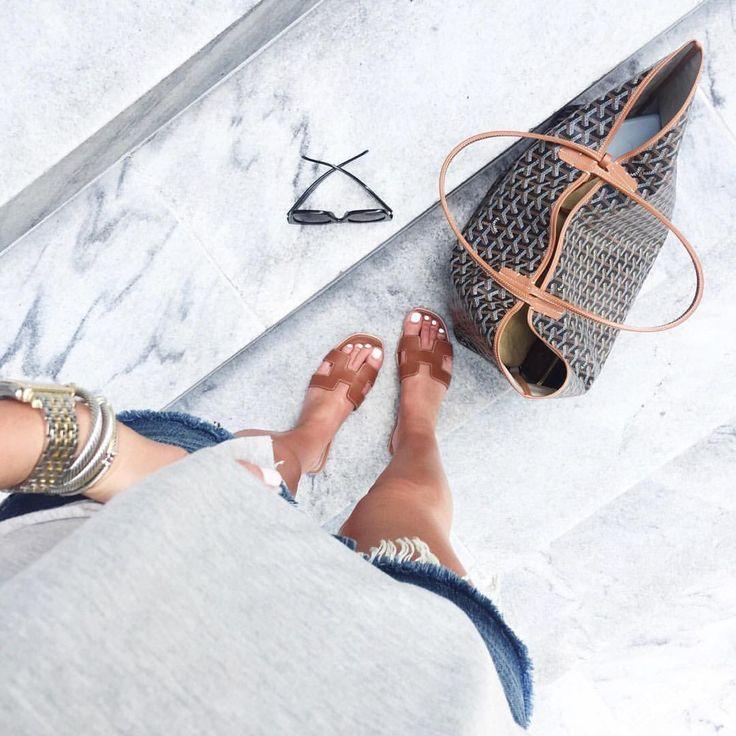 Hermes slide sandals and Goyard tote bag