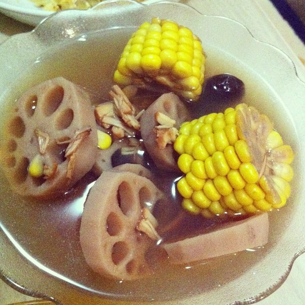 Healthy Asian soup with sliced lotus roots, sweet corn, red dates ...