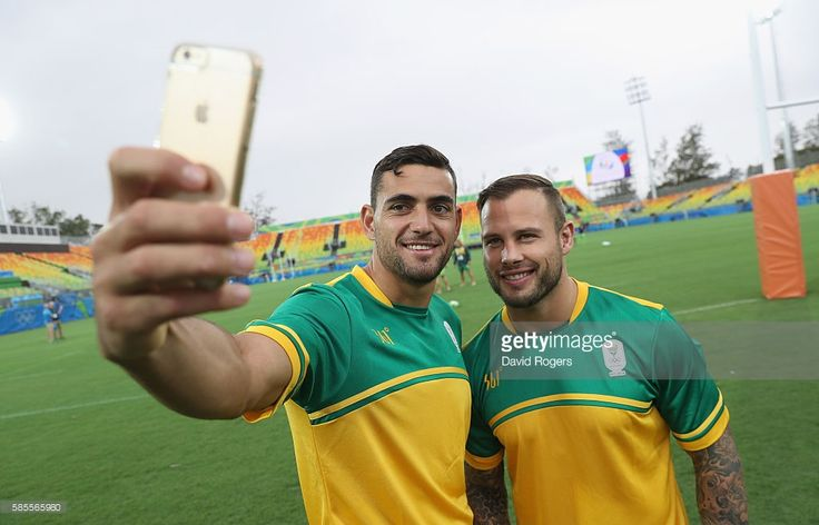 Chris Dry (L) and Francois Hougaard of the South Africa rugby teams pose for a selfie at the Deodora Olympic rugby stadium during the build up to the Rio Olympic Games on August 3, 2016 in Rio de Janeiro, Brazil.