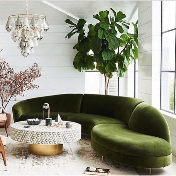 Check out this modern living room decor idea with emerald accents. Love it! #HomeDecorIdeas @istandarddesign