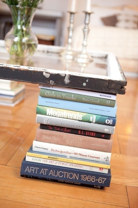 Get crafty and make your own coffee table with book legs! Much more on this wedsite.