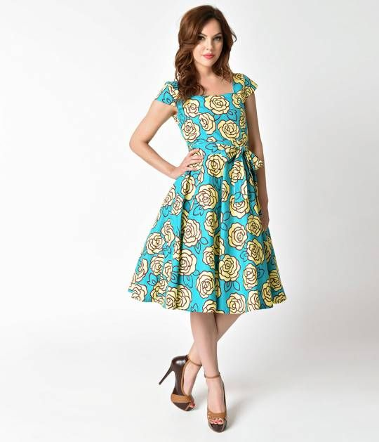 Hearkening back to the glamorous and marvelous 1950s, this aqua blue vintage style dress is truly something that will set any dame apart! Cast in a fabulous cotton with blooming yellow roses cascading through your elegant retro style figure. The princess