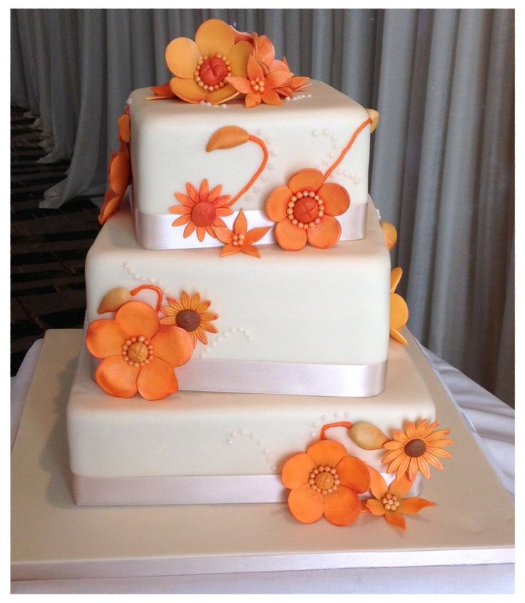 Autumn fantasy flowers cake. Offset square cakes with sugarpaste fantasy flowers in autumnal orange http://www.kellylou.com