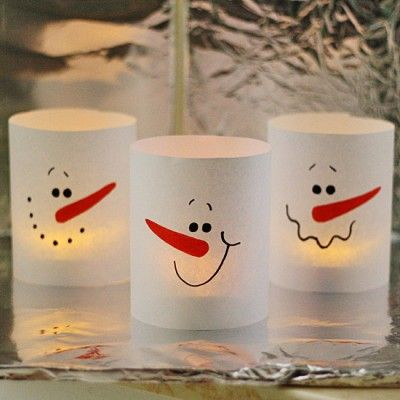 If you have a few minutes and a piece of paper, you can make these adorable snowman luminaries!