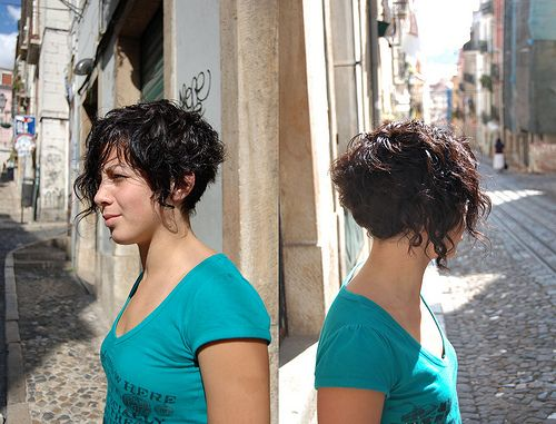 Street bob - haircut short curly   Coarse or curly hair? Reconsider your quest for short hair. Curly hair tends to frizz up when cut short and it can make hair too triangular. Coarse hair needs length to weigh it down. Try to stay a couple inches lower than the jaw (when hair is dry). < from about.com