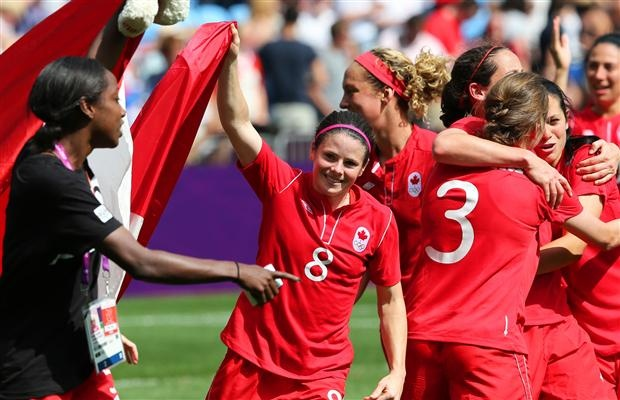 Diana Matheson (8), the winning goal scorer for Team Canada and other members of the team celebrate their team's bronze medal against France in the women's football match at the London 2012 Olympic Games, August 09, 2012. Canada won the bronze medal by beating France 1-0.