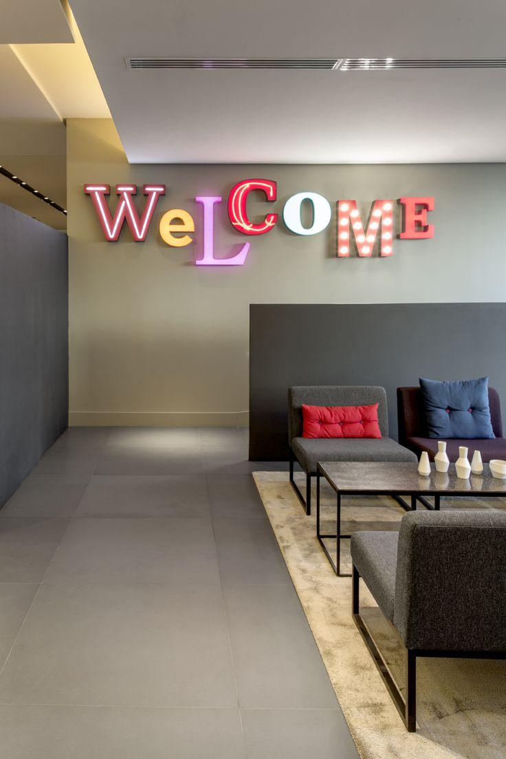 russia 2015 - azimut - international chain - living lobby - golden - reception - modern - vintage carpet - chair - neon letter - colors - design - rezeption - buchstaben - leuchtbuchstaben - schwarz - bunt - sessel