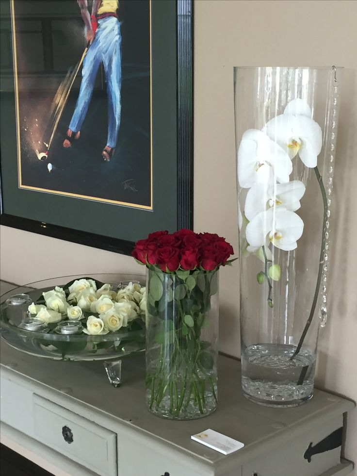Phalaenopsis orchid stem,  red roses and floating white roses