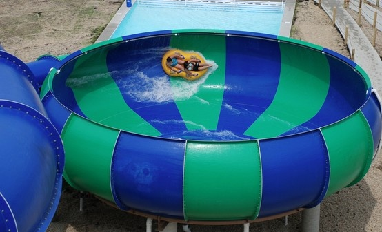 "The Cyclone - Slide down super fast - then get ""flushed"" into the bowl leaving your heart pounding and your head spinning."