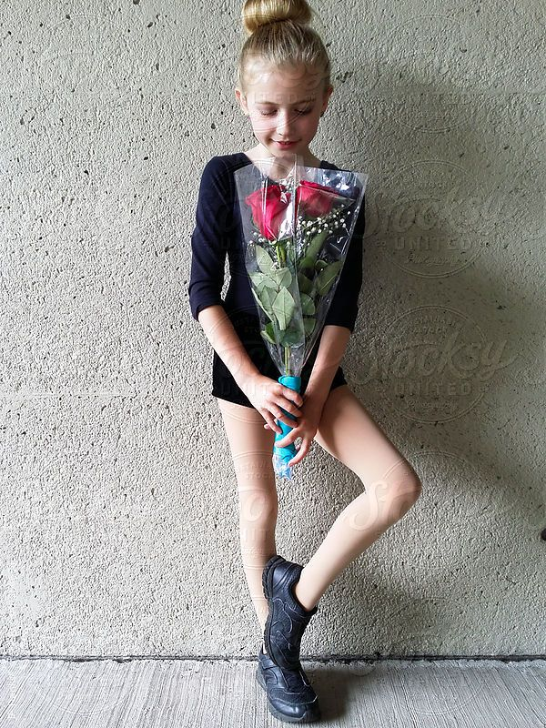 Little Girl Holding a Bouquet of Red Roses After Dance Recital by JP Danko for Stocksy United