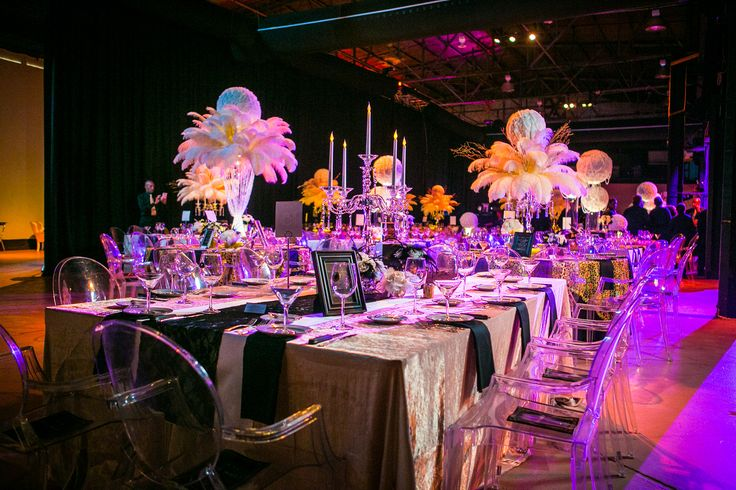 Gatsby themed event that is absolutely breath taking! Love the Black Lace over the Ivory and Champagne linens <3