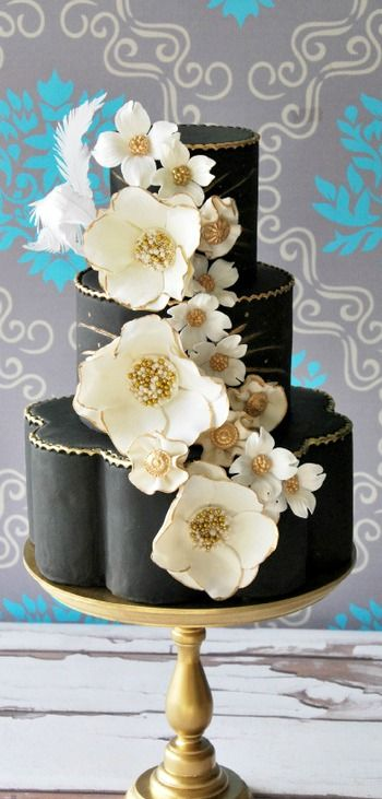 Cool black, white, and gold Wedding Cake