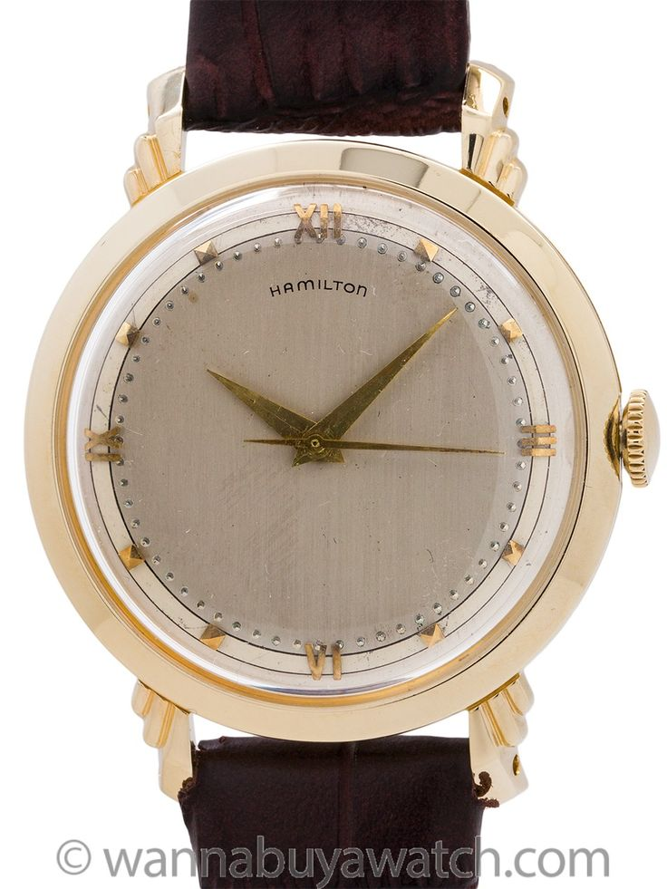 "Hamilton 14K YG ""Sedgman"" circa 1953 - An unusually large for the era 14K YG man's vintage Hamilton dress model circa 1953. Featuring 34 x 42mm case with ""winged"" design stepped lugs. With original very pleasing condition 2 tone silver satin dial with 18K YG applied Roman figures and indexes and inner gilt raised ""pearl"" minute indexes. Powered by 18 jewel manual wind caliber 748 movement with sweep seconds. Recently serviced and detailed and offered with our 1 year warrantee of accurate…"