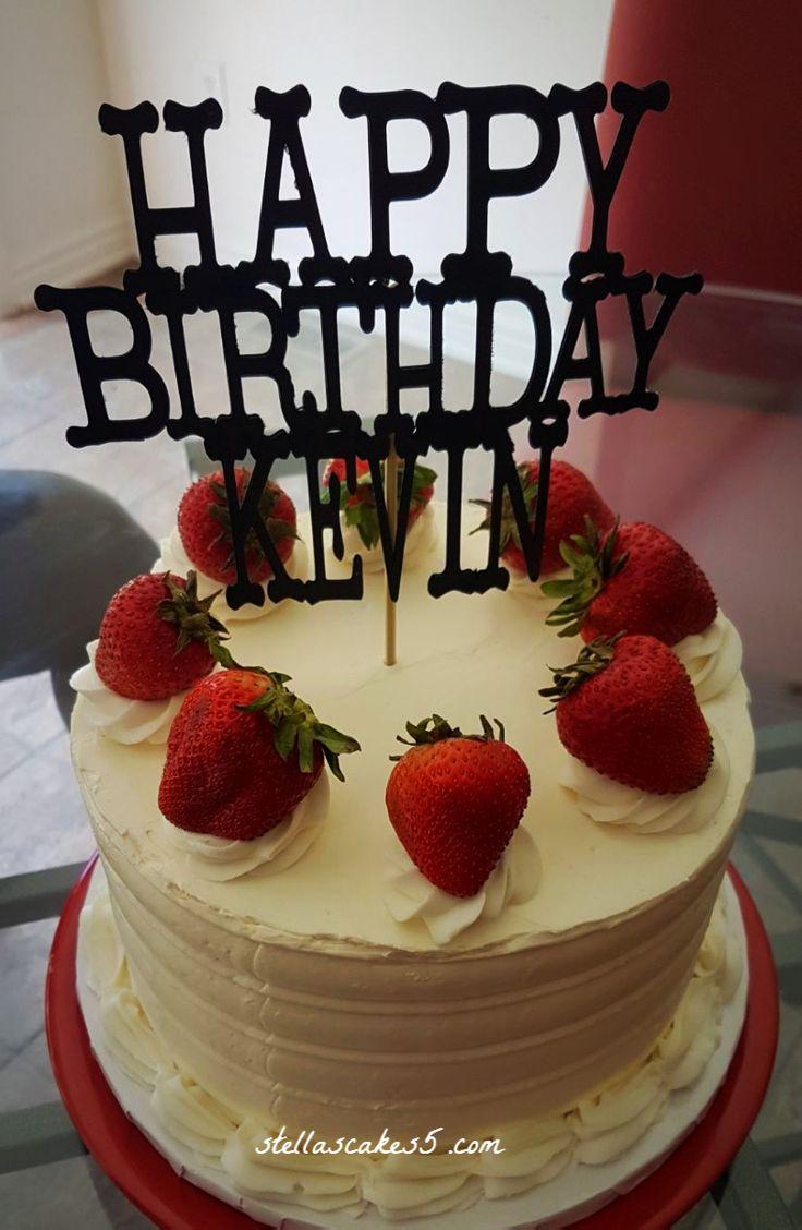 Strawberry Cake decorated with  fresh strawberries.