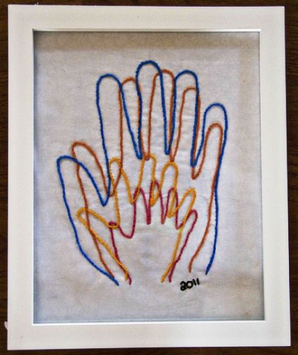 Love this idea, but with my daughter's handprints in different colors as she ages - and maybe on a pillow with her name added below?