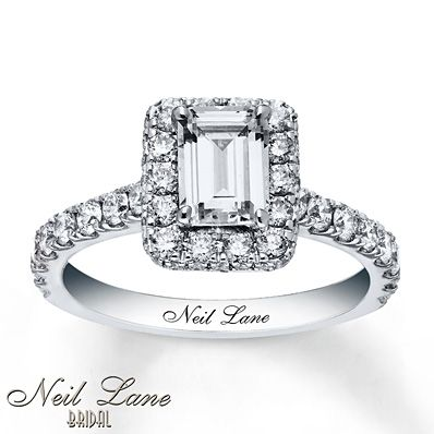 A sensational 1 carat emerald-cut diamond takes center stage is this unforgettable engagement ring from the Neil Lane Bridal® collection. Round diamonds frame the center and line the band for added splendor. Styled in 14K white gold, the ring has a total diamond weight of 2 carats. Neil Lane's signature appears on the inside of the band. Diamond Total Carat Weight may range from 1.95 - 2.11 carats.