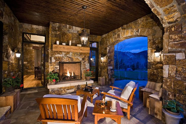Stone soldier archways frame views from the veranda while the outdoor fireplace provide warmth...love this bead board ceiling!Outdoor Living,  Eating House'S, Stones Wall, Fireplaces,  Eatery, Outdoor Retreat, Porchsunroom Ideas, Sinclair Architecture, Dreams Decks