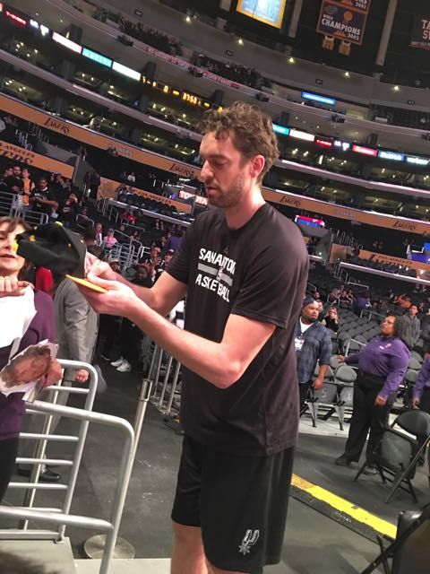 Pau signing autographs at Spurs game at Lakers, 2017