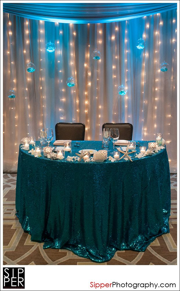 With maybe also with the seashells the flowers of the wedding also different table cloth