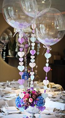 Balloon Table Center Pieces.  I love the confetti balloons!