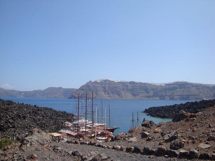 Ships in the harbor at the foot of the volcano Nea Kameni island (Νέα Καμένη), Santorini https://arturania.com/santorini