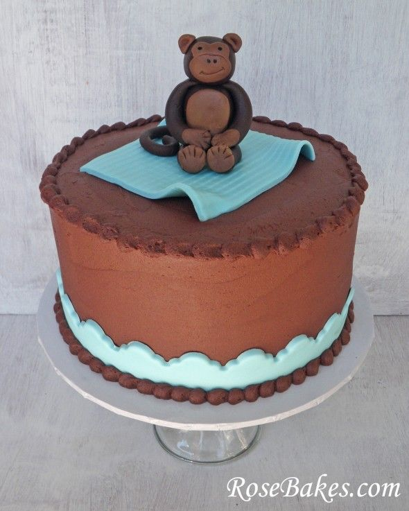 Chocolate Buttercream Monkey Baby Shower Cake with Fondant Monkey Cake Topper.  More pics here: http://rosebakes.com/chocolate-buttercream-monkey-baby-shower-cake-fondant-monkey-cake-topper/