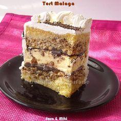 Tort Malaga un tort super buns, o imbinare perfecta intre bezea cu nuci, o ciocolata care o separa de crema si astfel ramane si crocanta , plus o crema fina de vanilie cu stafide.