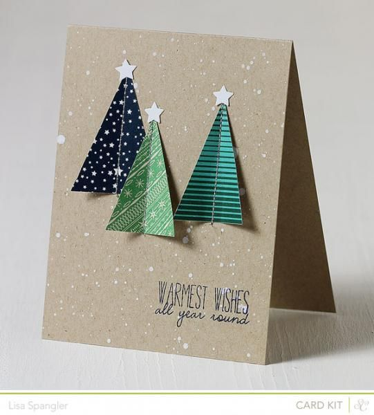 handmade Christmas/winter card ... triangle trees from printed papers machine stitched down the centers and pent upwards ... spritzed with the glittery, sparkly, white ink for a snowy day look ... like the clean and simple mod look ...
