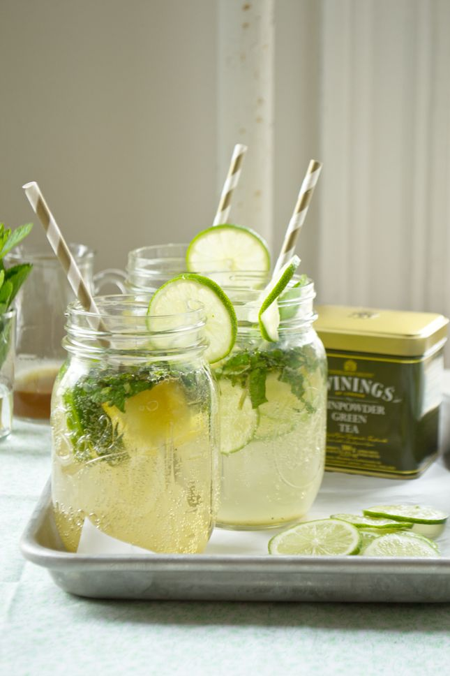 green tea mojitos.  –Mint, finely shredded  –Lime, thinly sliced  –Green tea ice cubes  –1 tbsp green tea simple syrup {Simple syrup:  ½ cup water ½ cup sugar 1 tablespoon (or 3 tea bags) strong green tea.}  –3 tbsps white rum  –Seltzer or club soda  –Lime slices for garnish