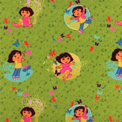 Woven dimout green with Dora the Explorer - Disney printed fabric. Great for DIY curtains in the nursery!