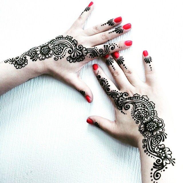 Henna tattoos and red nail polish