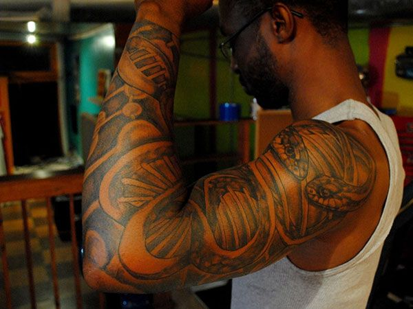 black people tattoos also include many designs with only words these words could come from. Black Bedroom Furniture Sets. Home Design Ideas
