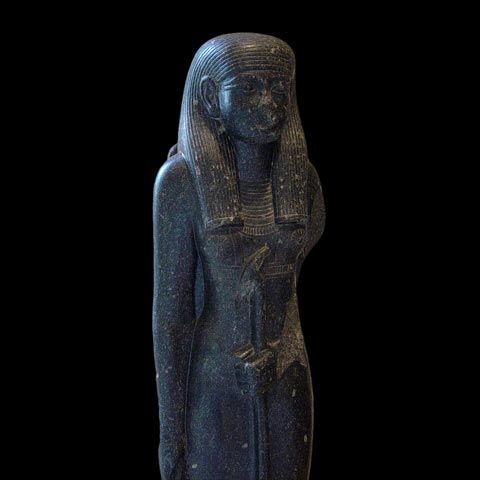 Black diorite statue of deity Nebt-Het (Nephtys). 18th dynasty, reign of Amenhotep III. Ancient Egypt. Louvre museum, Paris.