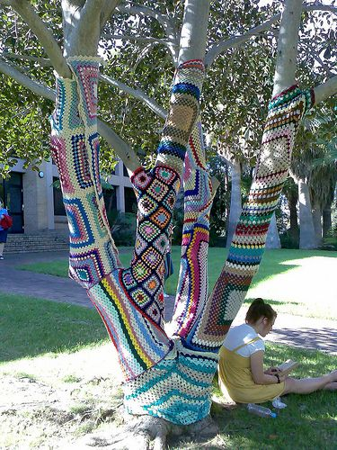 trees covered with knitted patchwork-