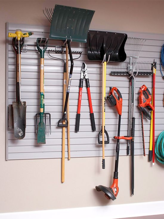 I wish the tools in my garage were this organized.  I love the idea of the moveable hooks.  You aren't drilling tons of holes in your walls, and you can rearrange as you need to.