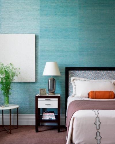 A light sky blue bedroom.