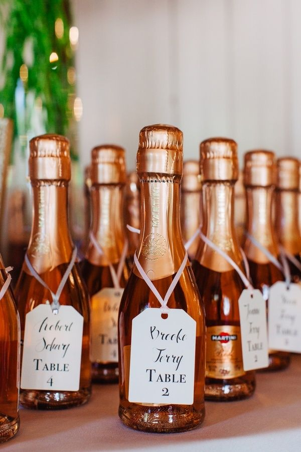 Mini champagne bottles as escort cards // Riverland Studios