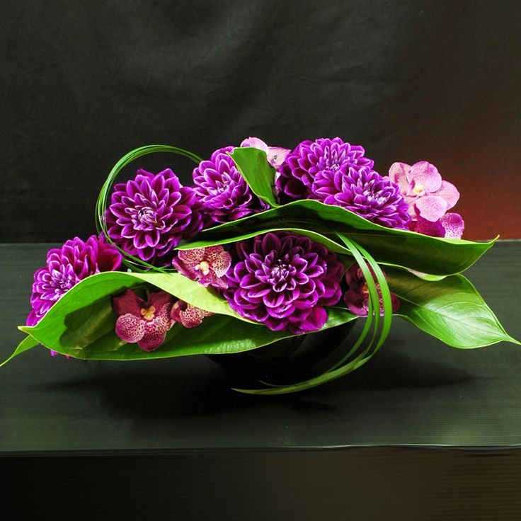 Unusual purple and green floral creation of #purple #dahlias and #orchids - Kfloral design