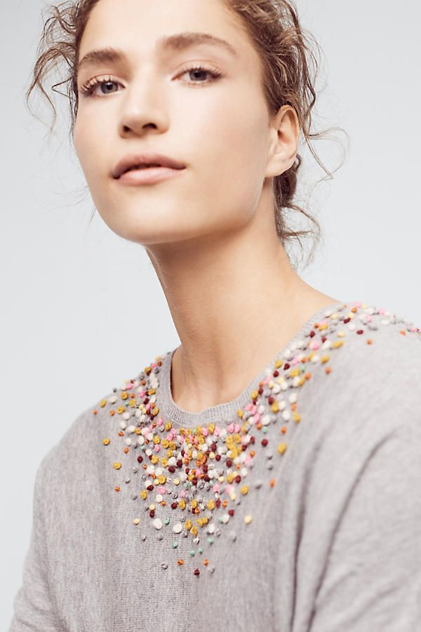 French knots embellish a simple pullover sweater