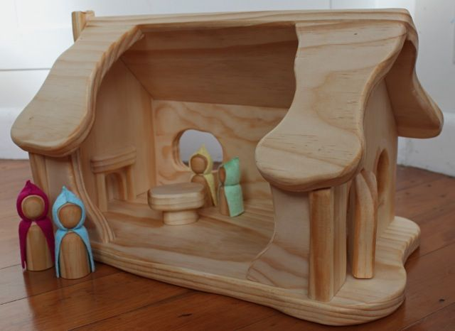 Lovely solid wood gnome home. This house is carefully made with solid pine with 3 little windows and a lovely curvy chimney going up the outside of the house.   Inside you will find an inviting fireplace, a wooden table and all wood hinged front door. Finished with natural high quality tung oil.  Th...