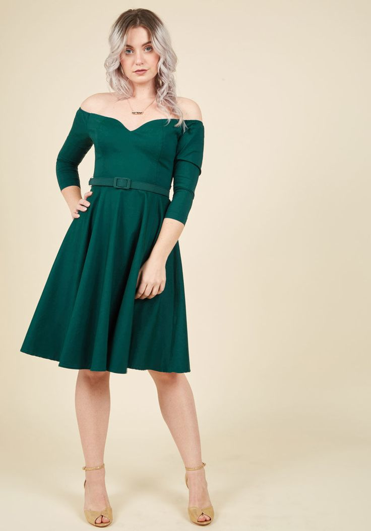 <p>Spinning this forest green dress onto the scene, you invite honest feedback. To your delight, its off-the-shoulder silhouette, sweetheart neckline, 3/4-length sleeves, and self belt earn this flared dress nothin' but lovin' from every single onlooker!</p>