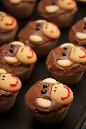 This is a decoration idea, so you can use whatever kind of cupcake recipe you want!  Use chocolate chips for the eyes and little dots of frosting for the nose (Monkey Cupcakes // Elle and Blair)