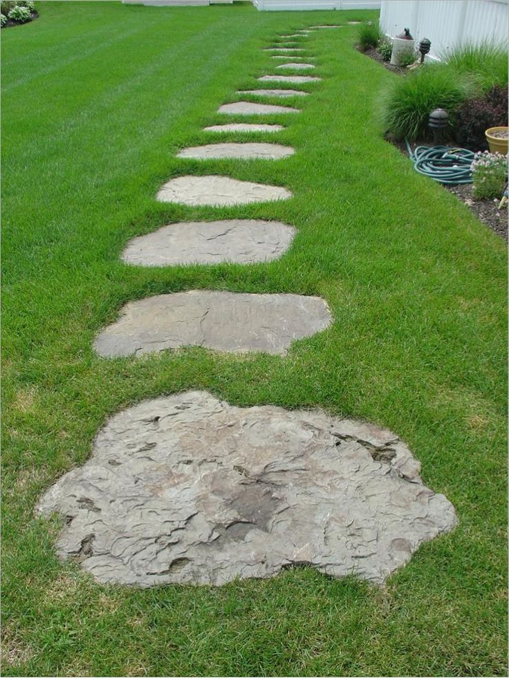 Flagstone stepper walkway through grass garcia residence for Stone path in grass