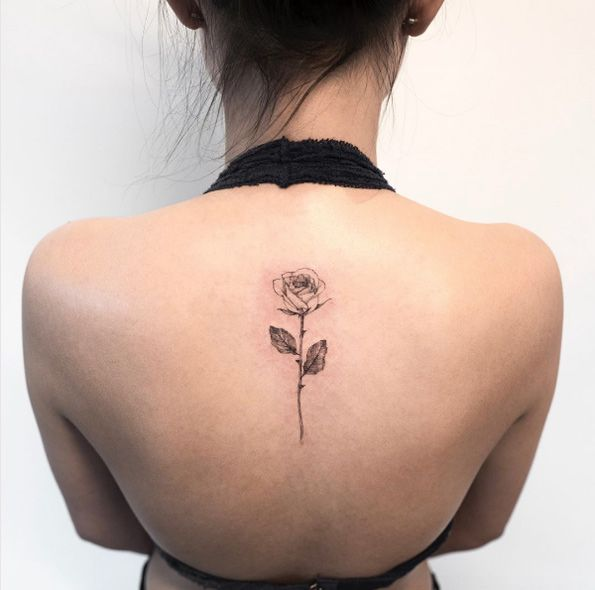 Single rose on back by Hongdam