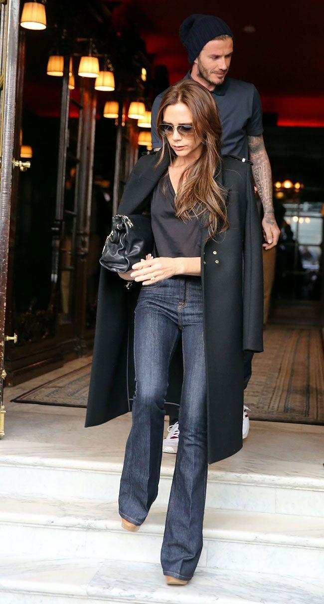 Victoria Beckham flared dark denim and coat over the shoulders