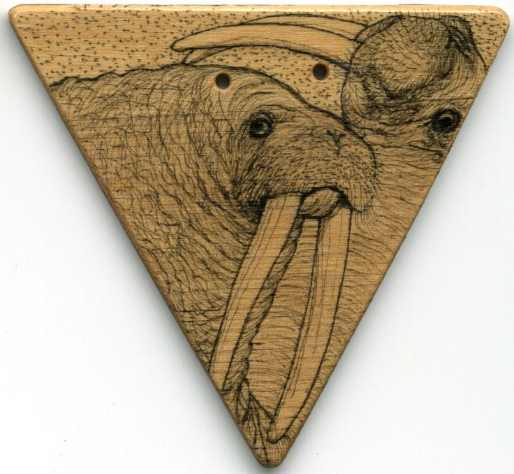 Pendant. Two walruses drawn on wood with chinese ink, lackered. The holes are for the leatherstring. By www.najaabelsendk