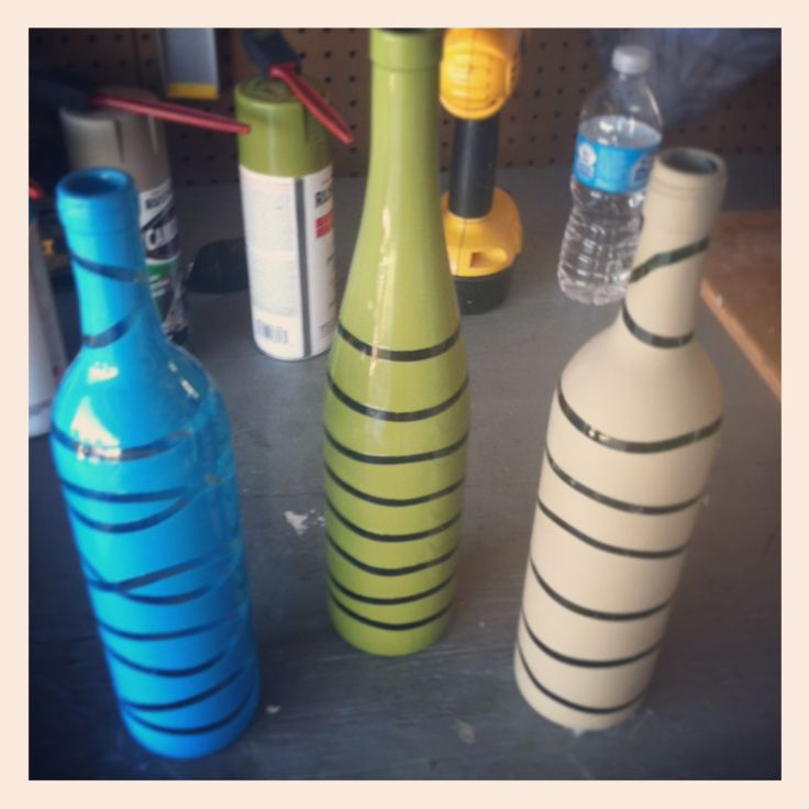 reuse old wine bottles: place rubber bands in any pattern around bottles, spray paint, let dry, and then cut off bands. Easy DIY!