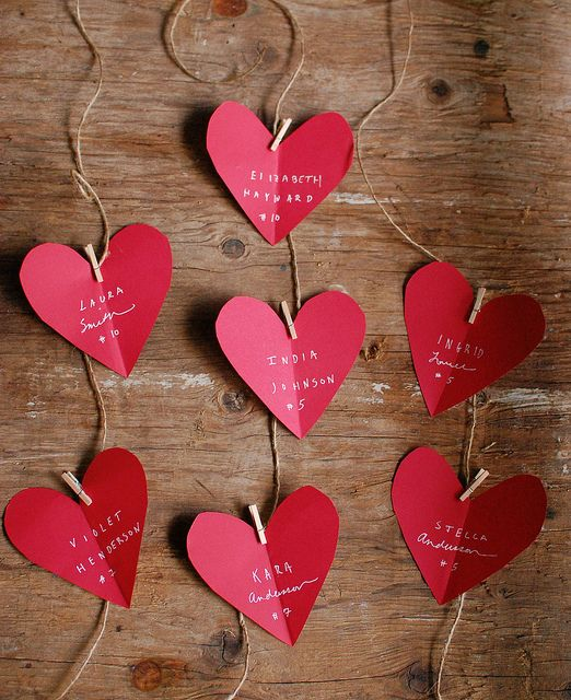 hang hearts with paper clips on string; write sweet nothings on them for your sweetie to find on valentine's day