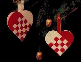 Heart ornaments from red and white cut paper for St Lucia Day